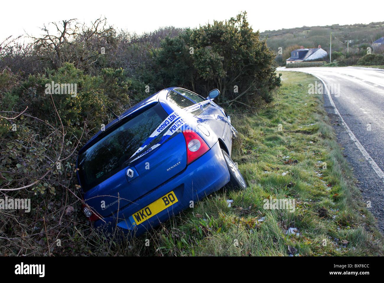 a car crashed, skidded on ice on a country lane, uk - Stock Image