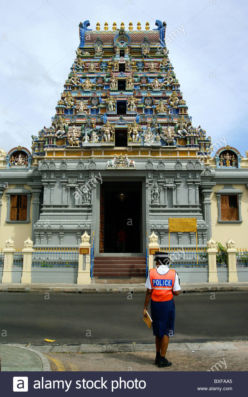 female creole police woman at Navasakthi vinayagar hindu temple in Victoria capital city of the Seychelles - Mahé - Stock Image