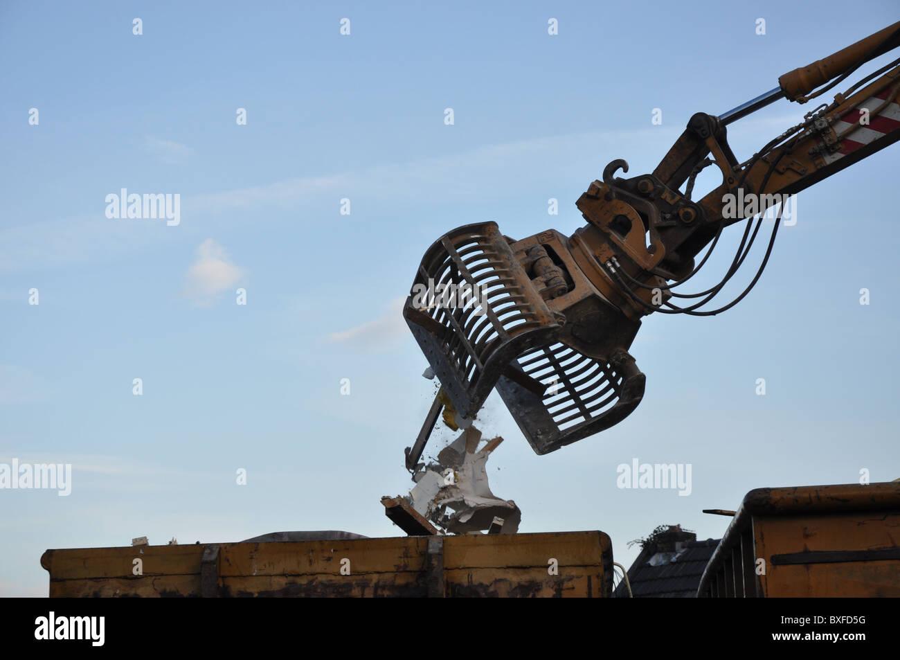 Crane lifting debri - Stock Image