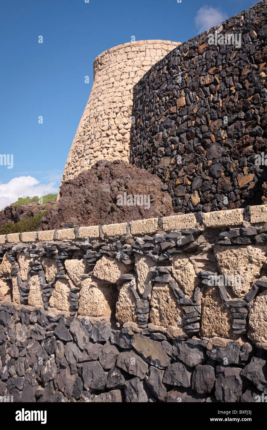 Various types and colours of volcanic rock used for building walls and a kiln in Playa San Juan Tenerife Canary - Stock Image