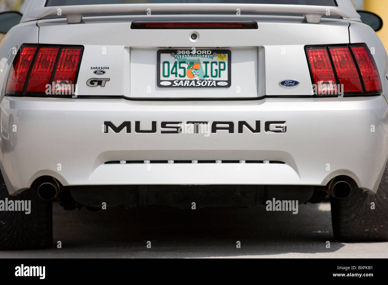 Vehicle registration plate on Ford Mustang GT sports vehicle in Anna Maria Island, United States of America - Stock Image