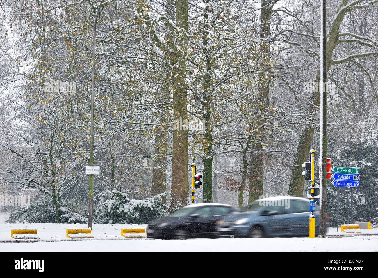 Cars driving on slippery road in winter in the snow, Ghent Belgium Stock Photo