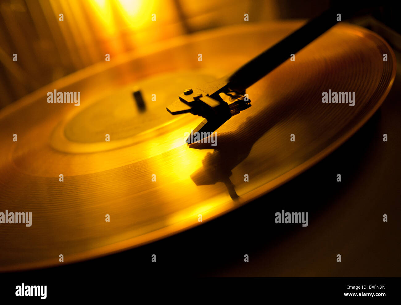 A record playing on a vinyl turntable deck - Stock Image