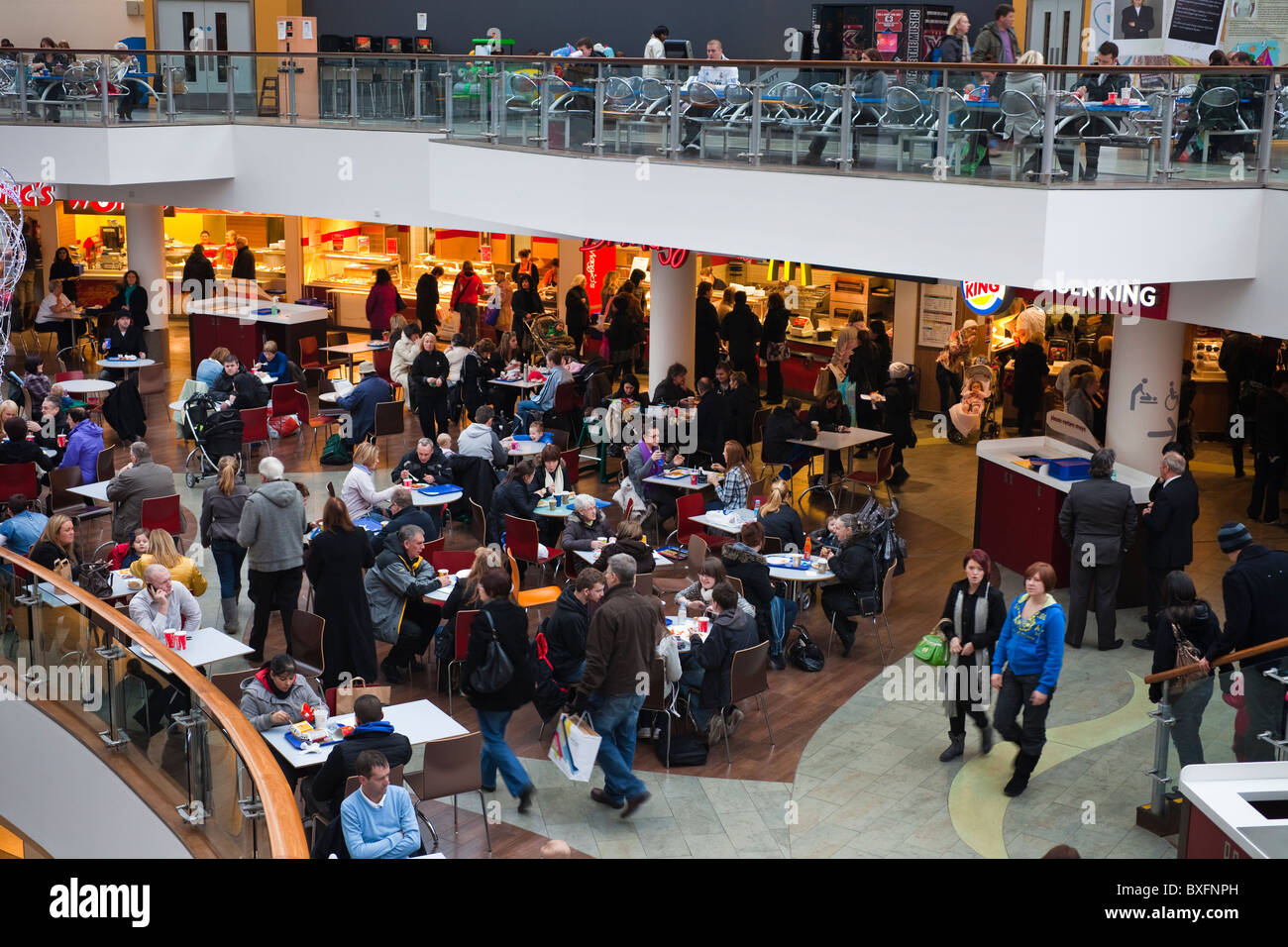 Fast food restaurants and seating area in a modern shopping mall Stock Photo