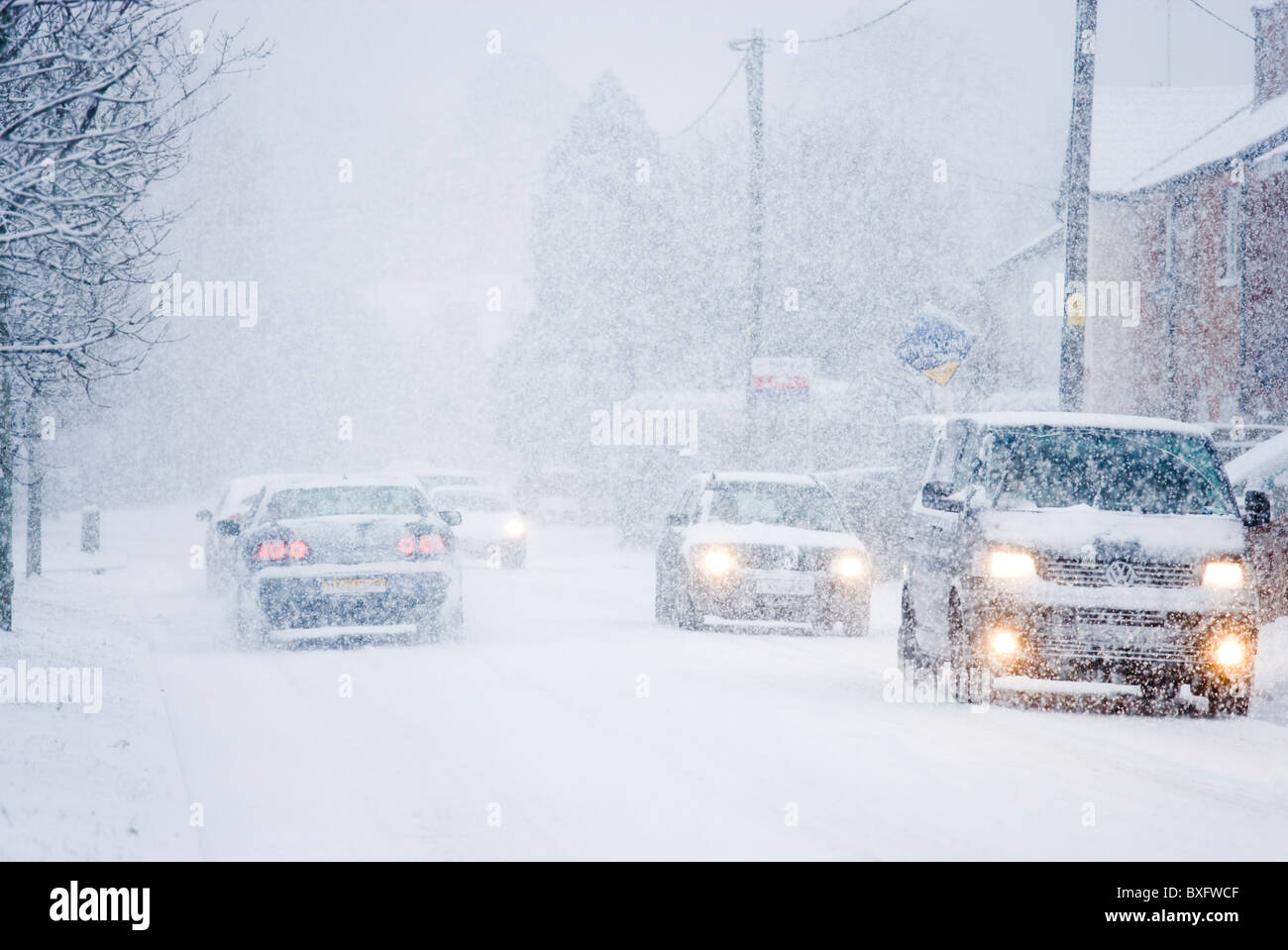 Cars in blizzard. Surrey, UK - Stock Image