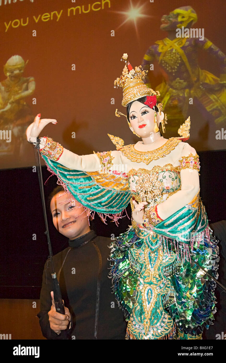 Puppeteers display puppets from the puppet show at Askra Theater in Bangkok. - Stock Image