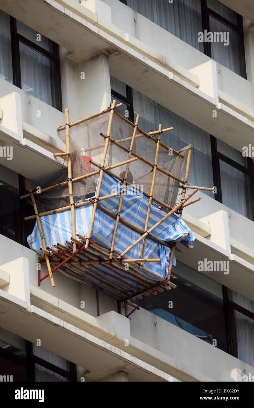 Bamboo scaffolding at a high building in Hong Kong - Stock Image