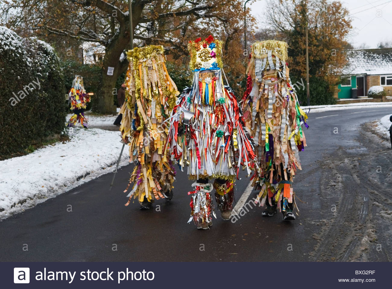 Masks being work at traditional English village mumming play Otterbourne Hampshire UK HOMER SYKES - Stock Image