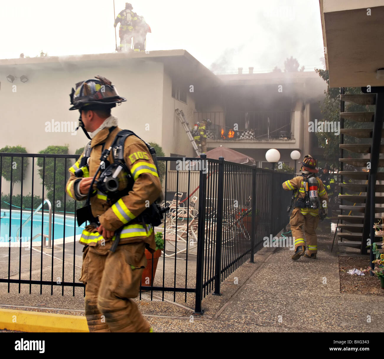 SACRAMENTO, CA - August 28, 2010: Sacramento Metro Fire District firefighters rush to rescue Stock Photo