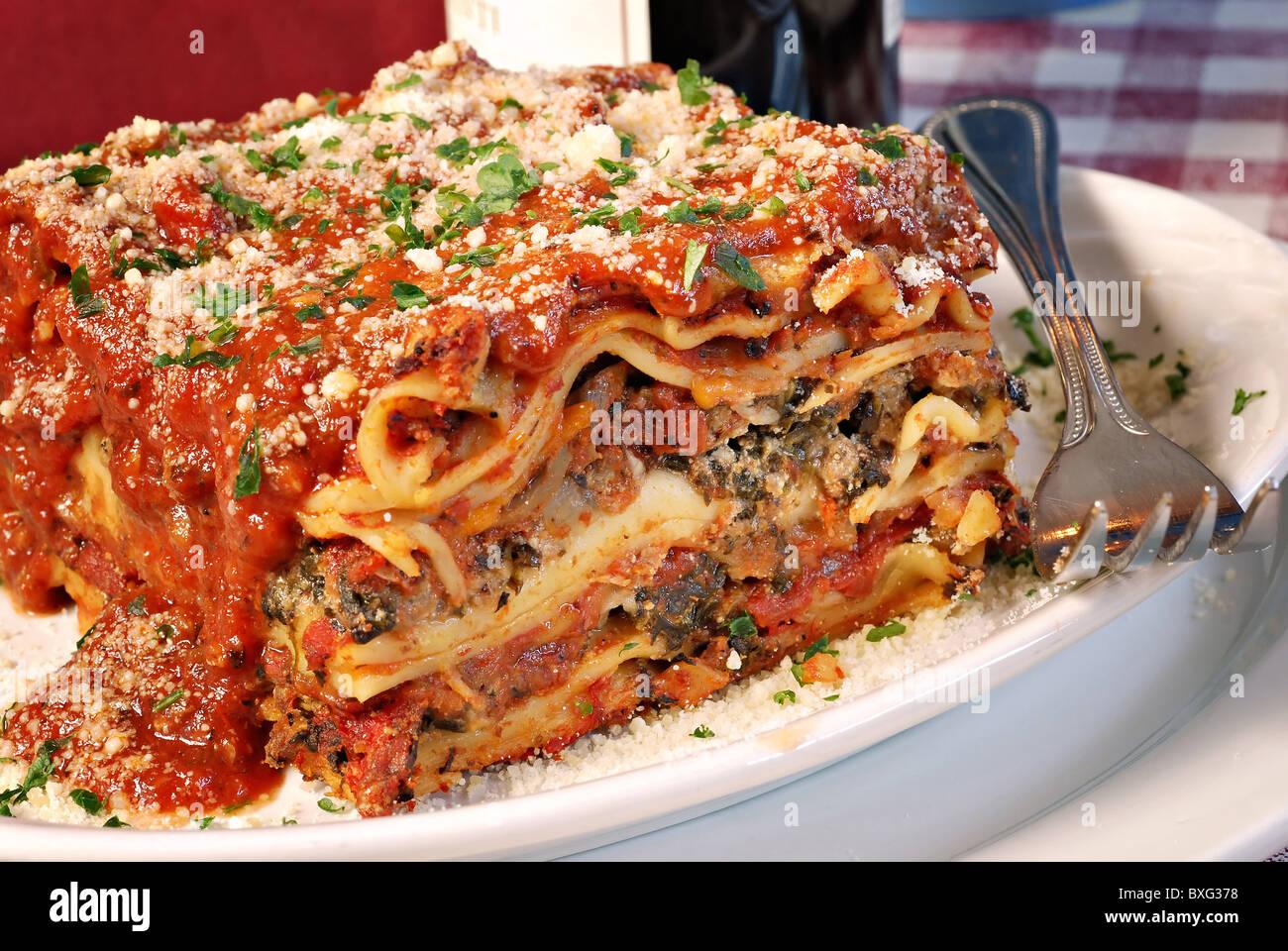 Plate of lasagna at an Italian restaurant Stock Photo