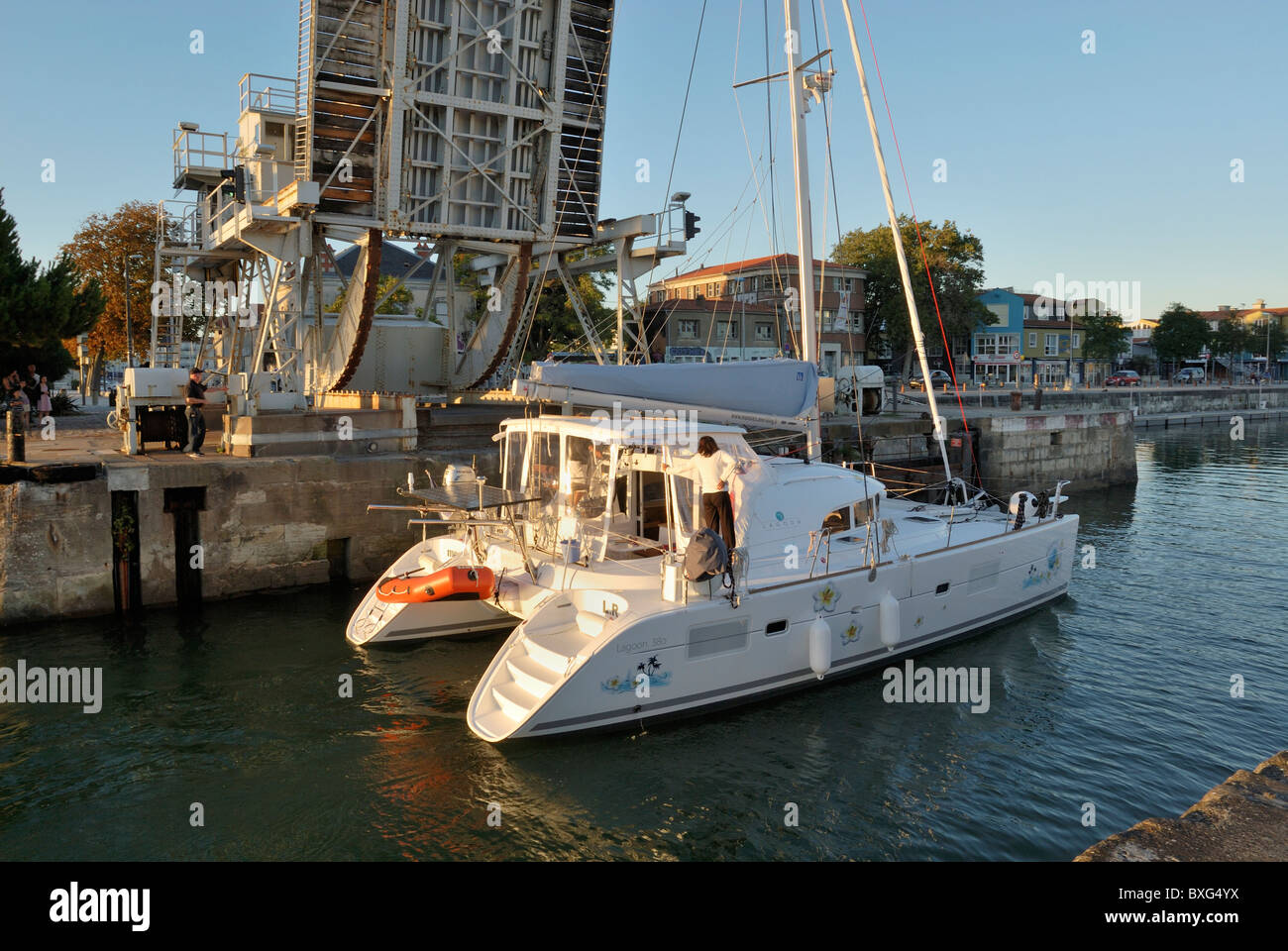 Gabut Bascule rolling lift bridge raised as Catamaran enters the inner harbor of La Rochelle, Charente-Maritime - Stock Image