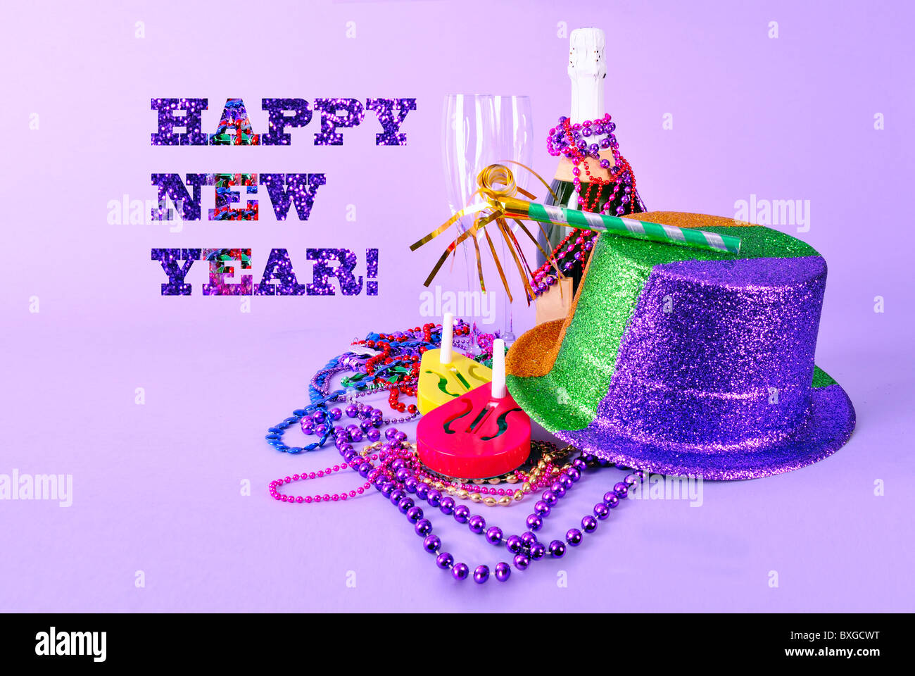 Happy New Year card New Years Eve invitation 2011 with party favors and champagne bottle flutes noisemakers party - Stock Image