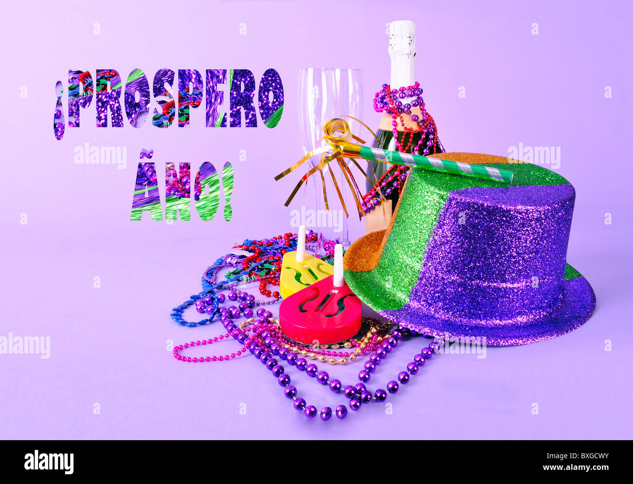 Spanish Holiday card or party invitation Prospero Ano Happy New Year 2011 still life champagne bottle flutes noisemakers - Stock Image