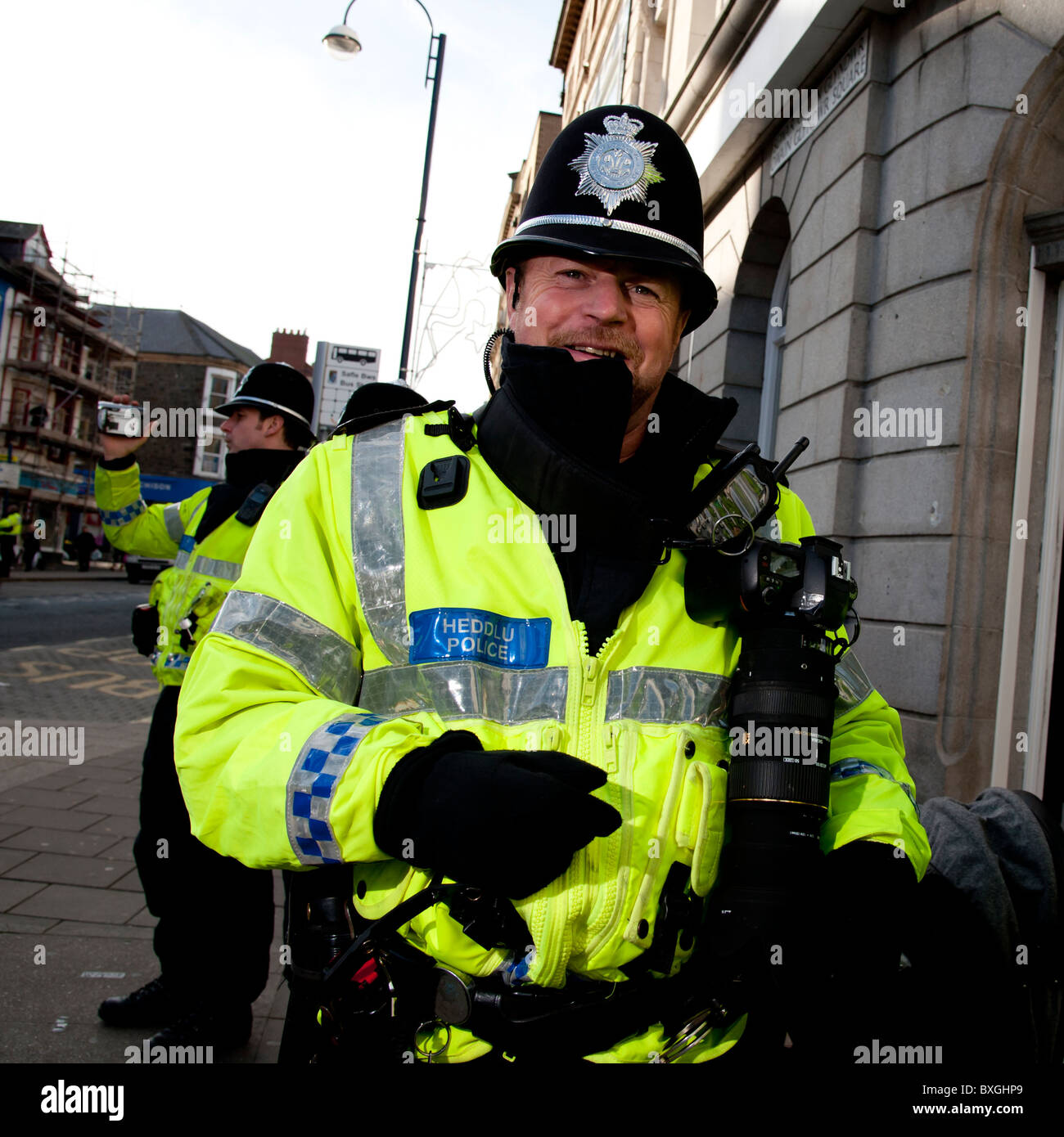 Police FIT forward intelligent team officers at student protest against education cuts, Aberystwyth Wales UK - Stock Image