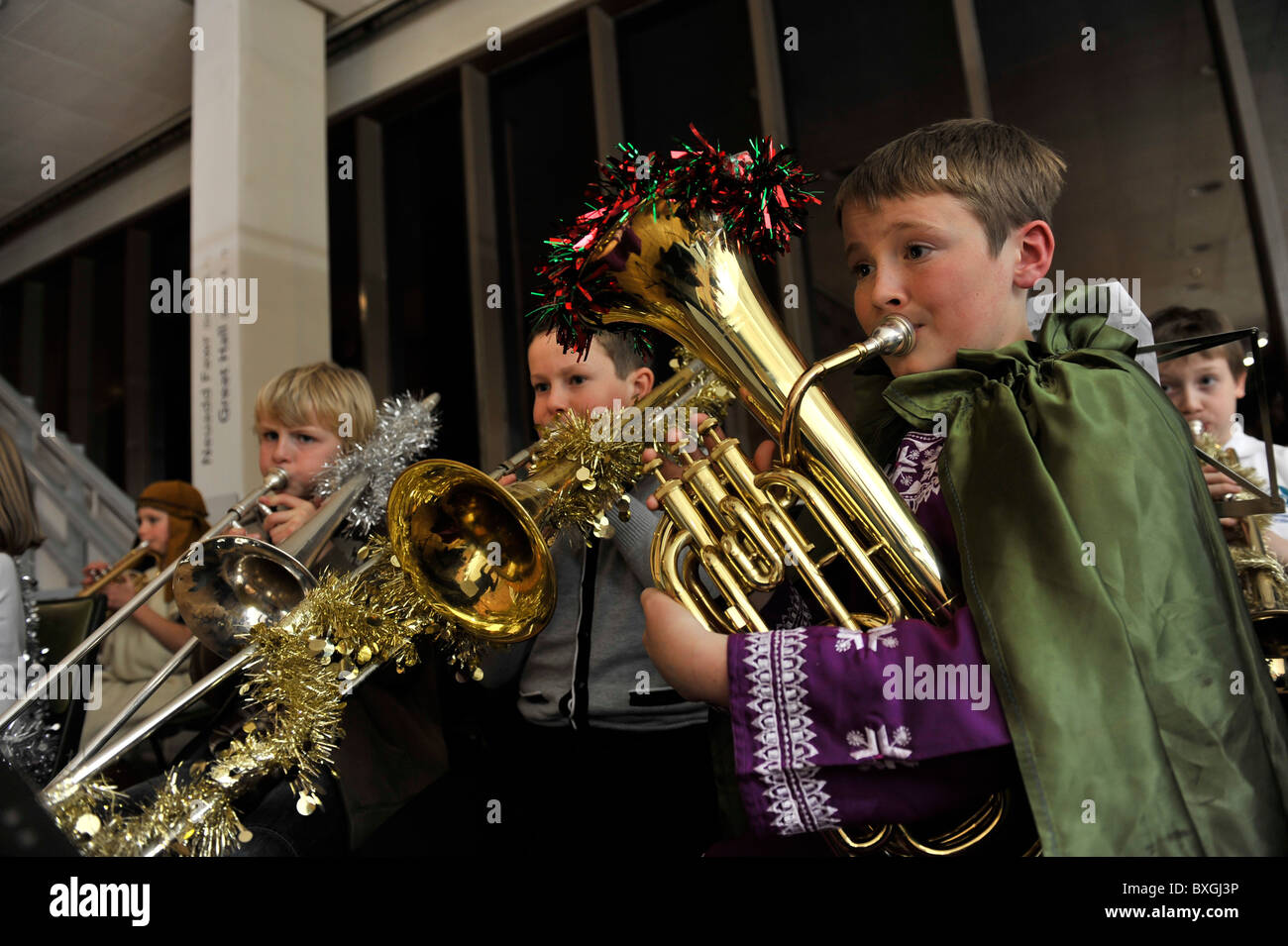 Children playing musical instruments in a primary school christmas nativity play, UK - Stock Image