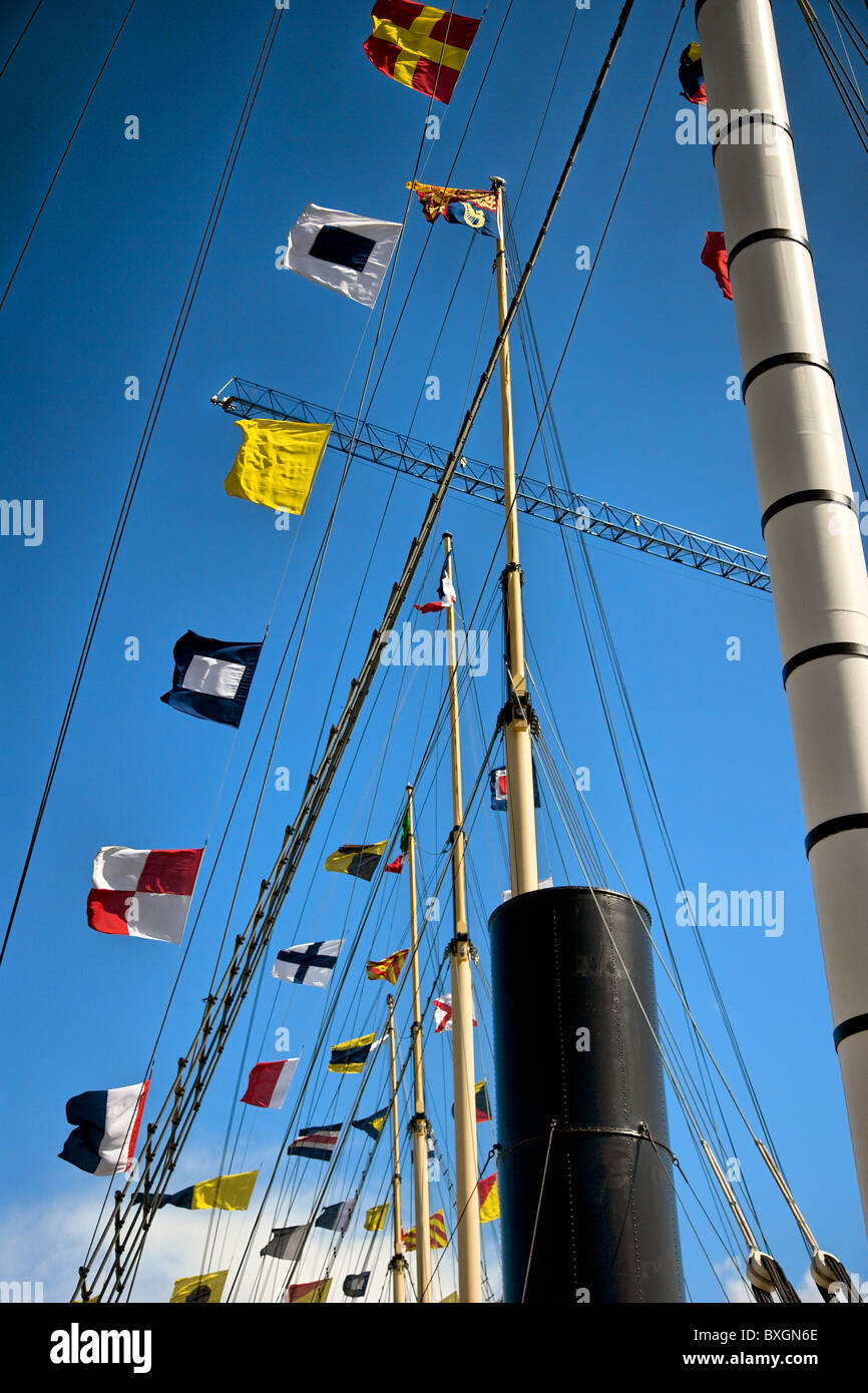 Flags masts and funnel of the SS Great Britain in the floating harbour at Bristol - Stock Image