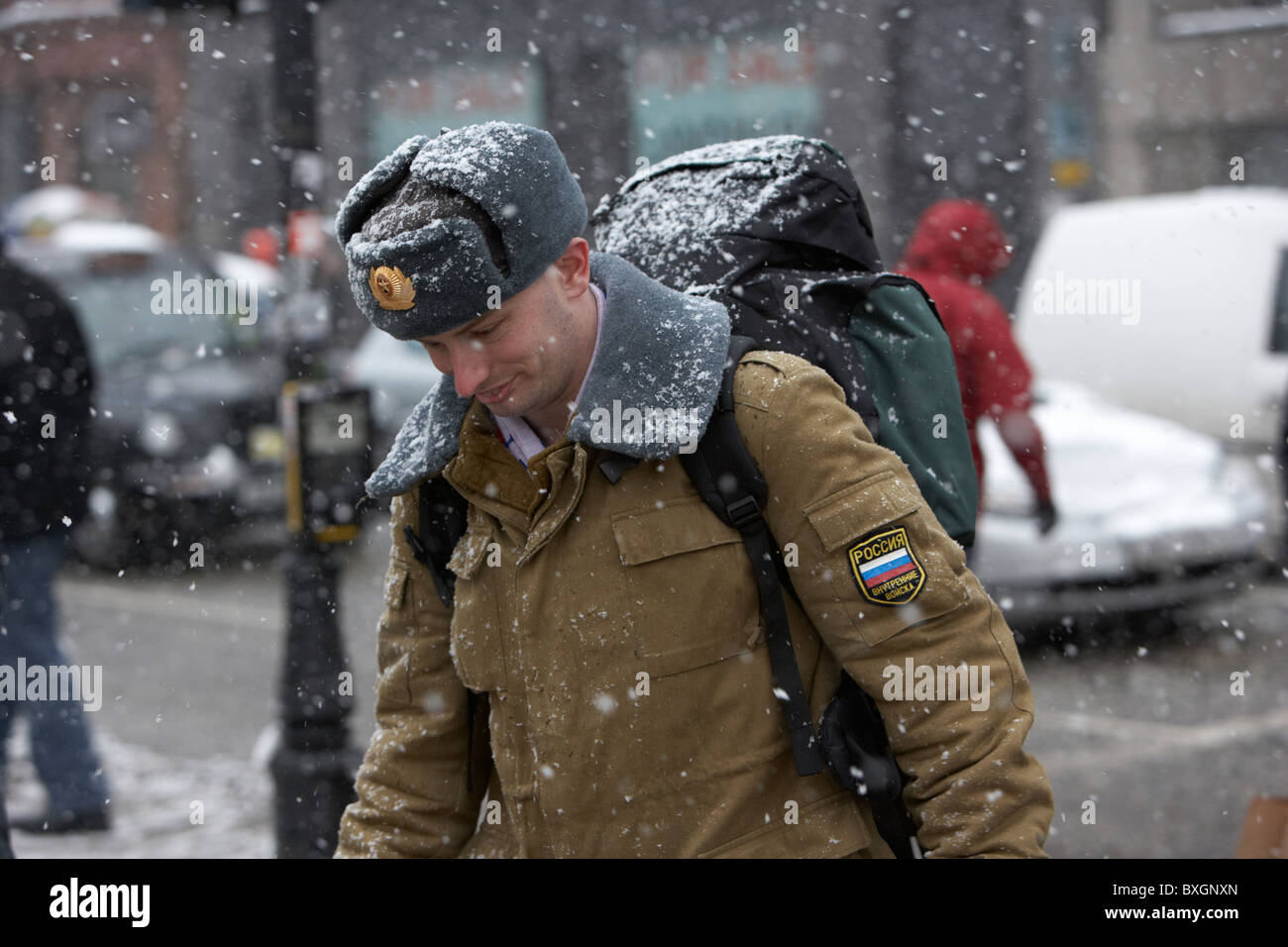 aafa19e6cd9 man wearing russian hat and russian uniform and rucksack on a cold snowy  winters day Belfast Northern Ireland