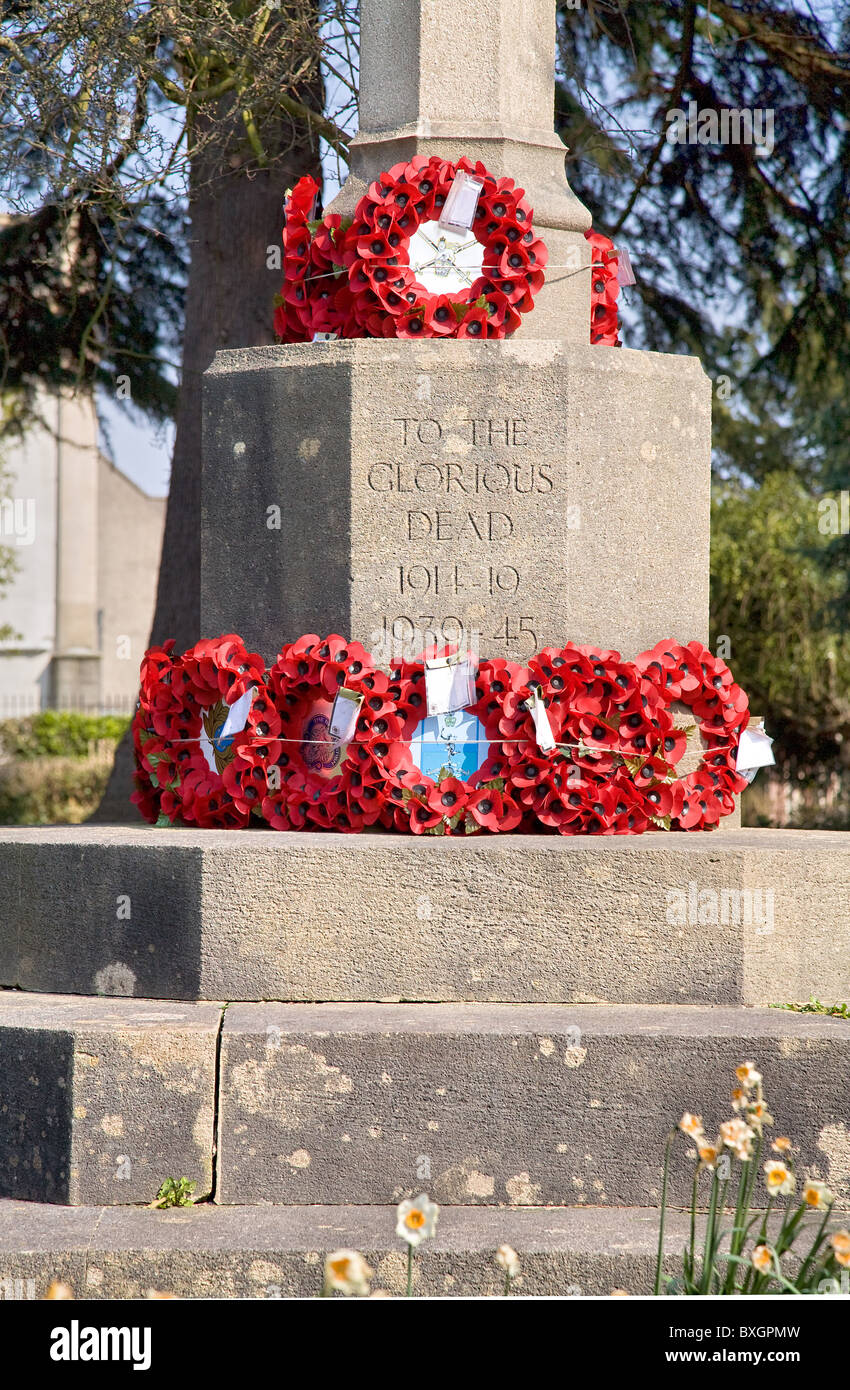 Poppy wreaths laid on a war memorial in Clifton graveyard Bristol - Stock Image