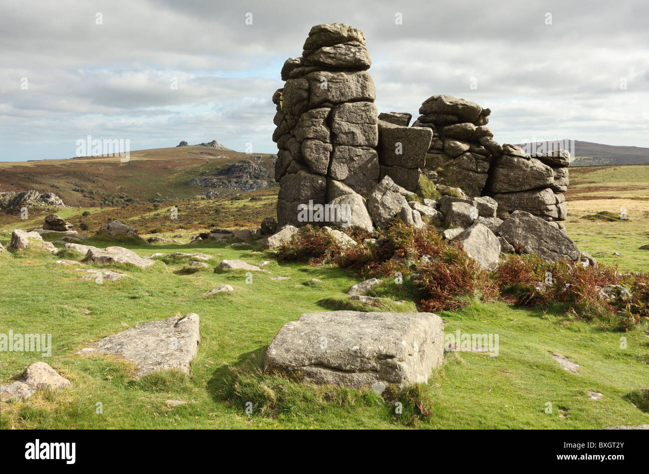 Rocks at Hound Tor with Hay Tor in the distance - Stock Image