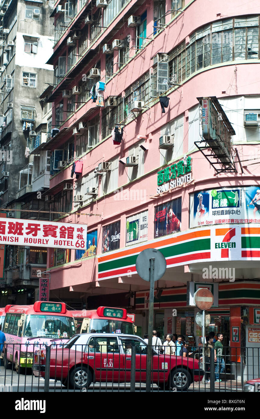 Busy street with public light buses and advertising signs, Mong Kok, Kowloon, Hong Kong, China - Stock Image