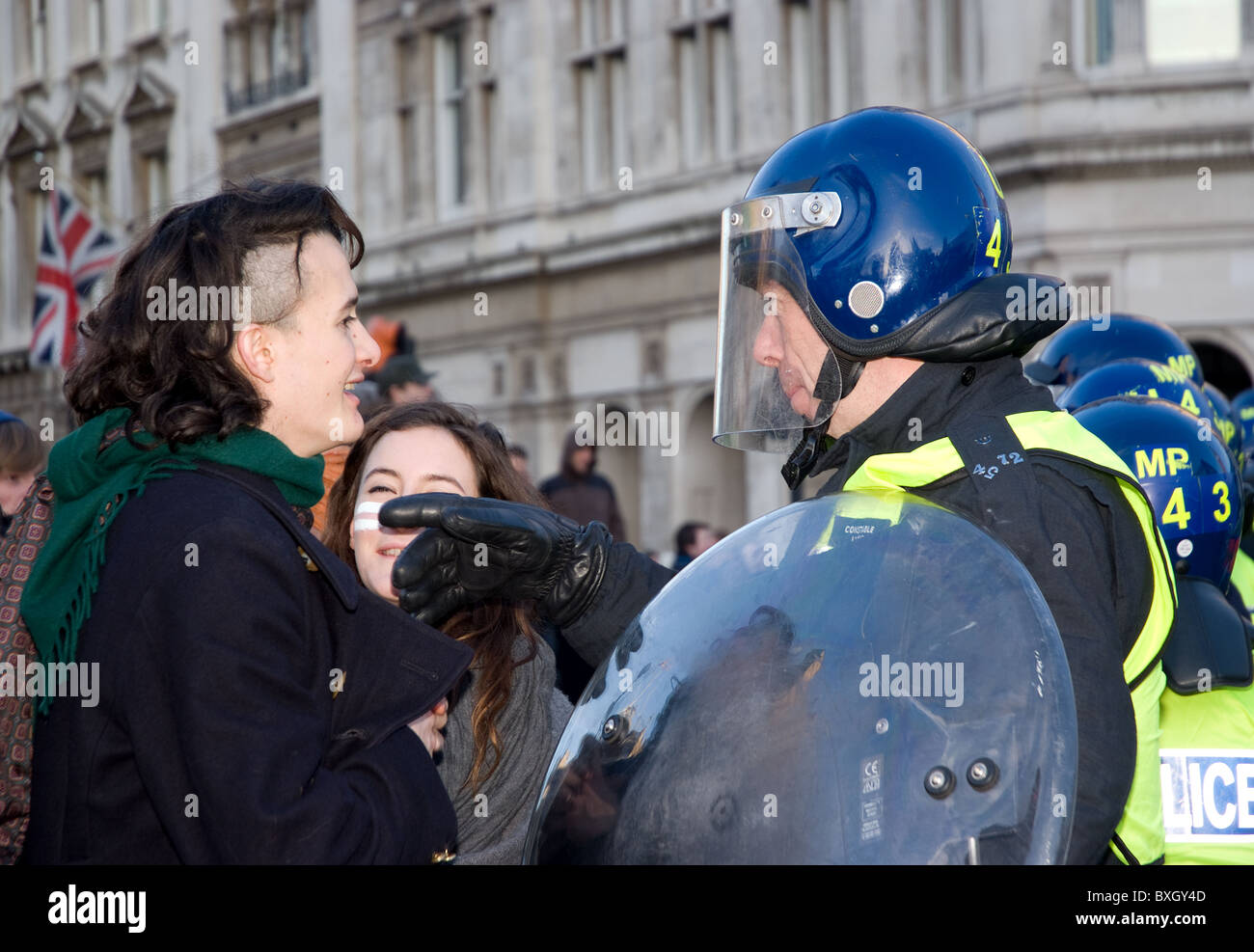 Charlie Gilmour gets a telling off from a police officer during a student protest - Stock Image