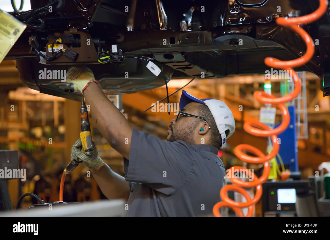 Detroit, Michigan - A worker assembles the a car at General Motors' Detroit-Hamtramck Assembly Plant. - Stock Image