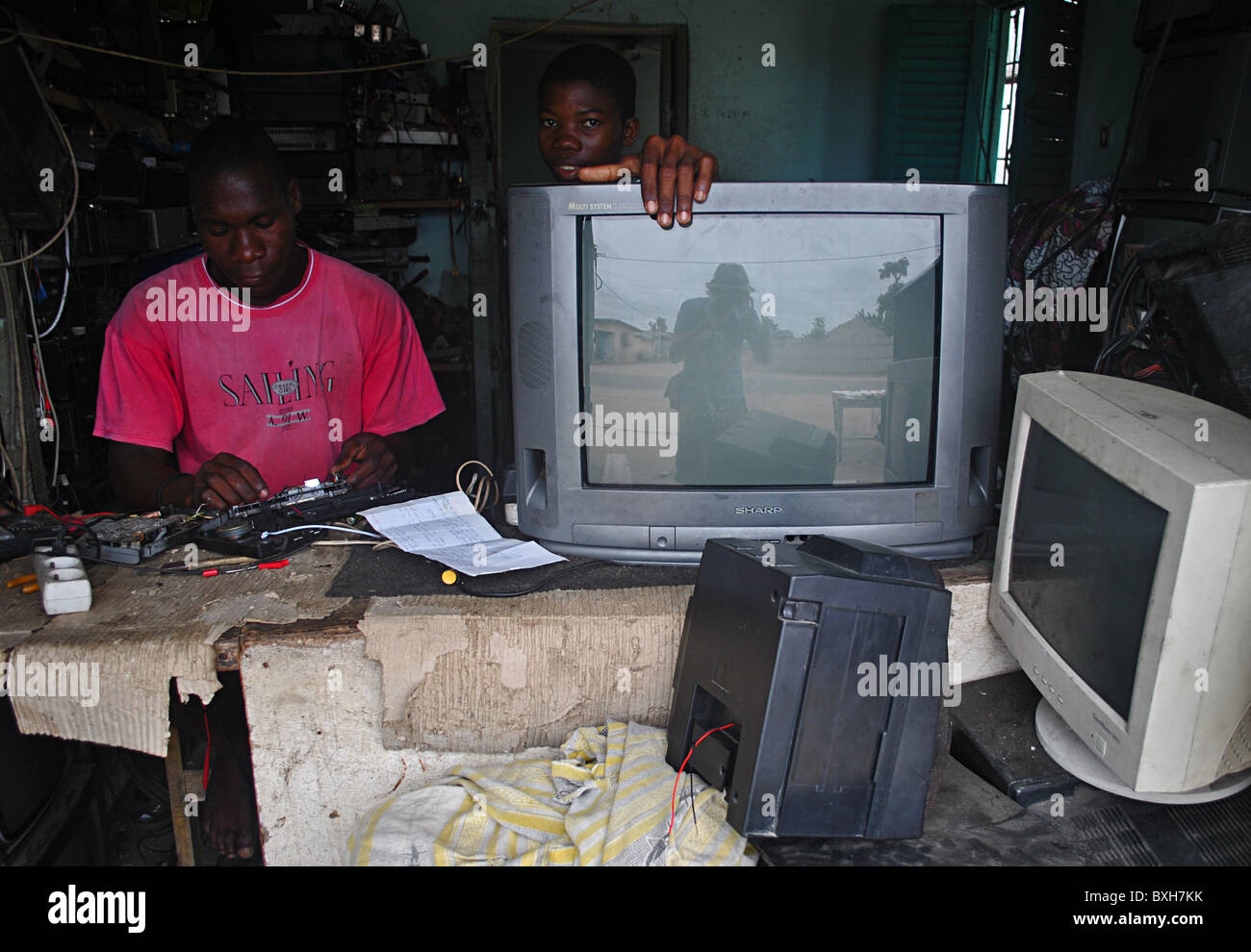 Man fixing second-hand computers in Ivory Coast, West Africa