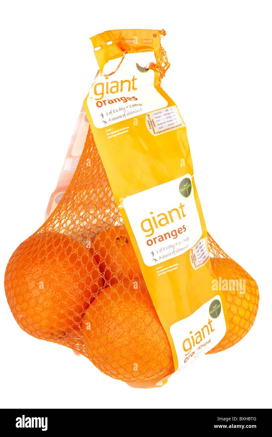 Orange net bag of Nurture giant oranges - Stock Image