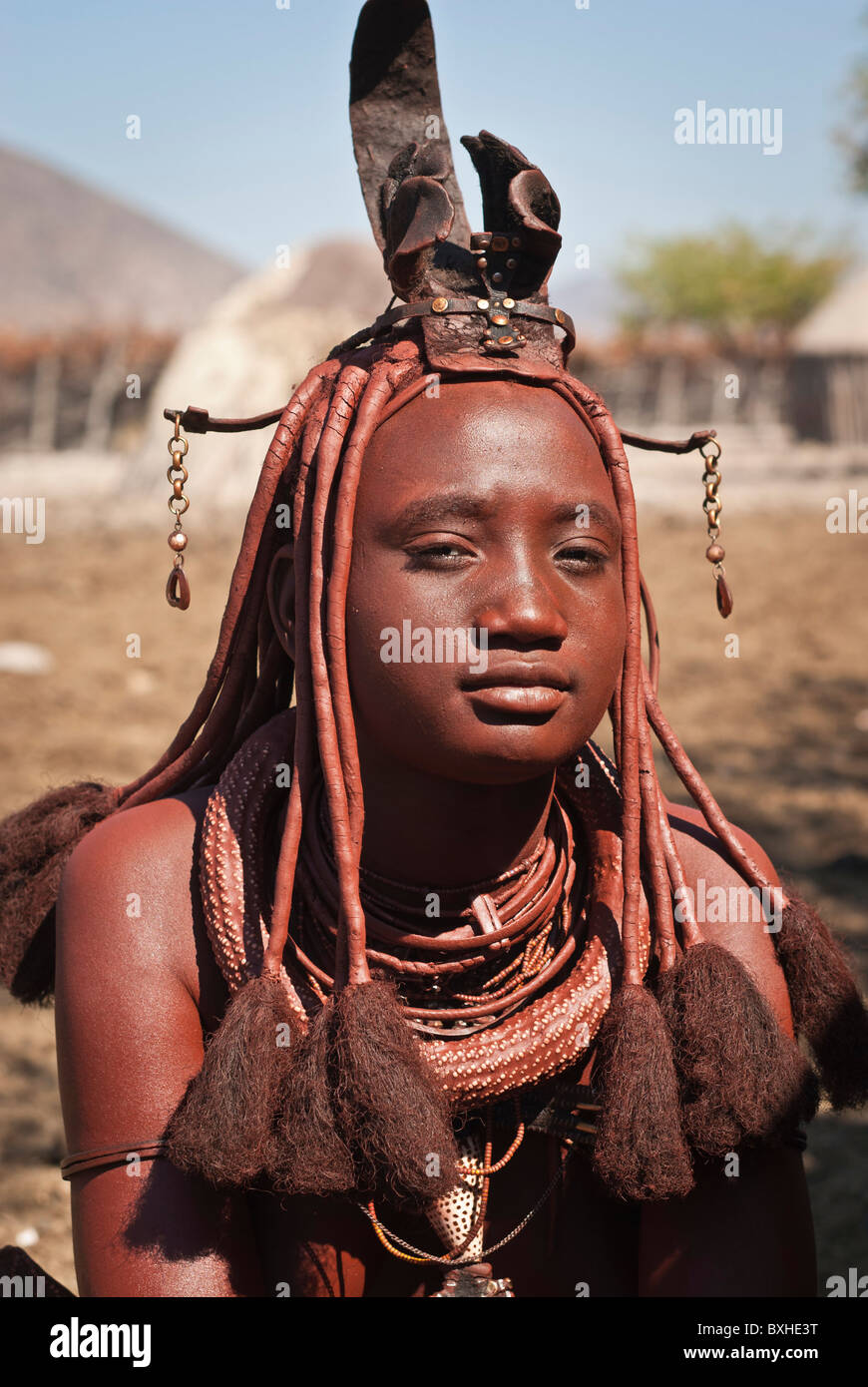 Himba woman in a village near Epupa Falls, Namibia, Africa. - Stock Image