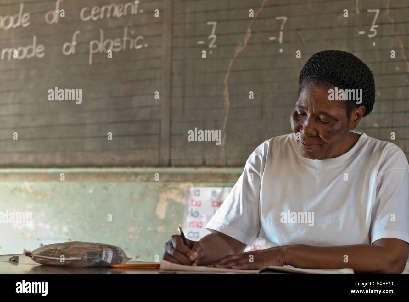 Teacher in the school, Chinotimba, Vicfalls, Zimbabwe, Africa - Stock Image