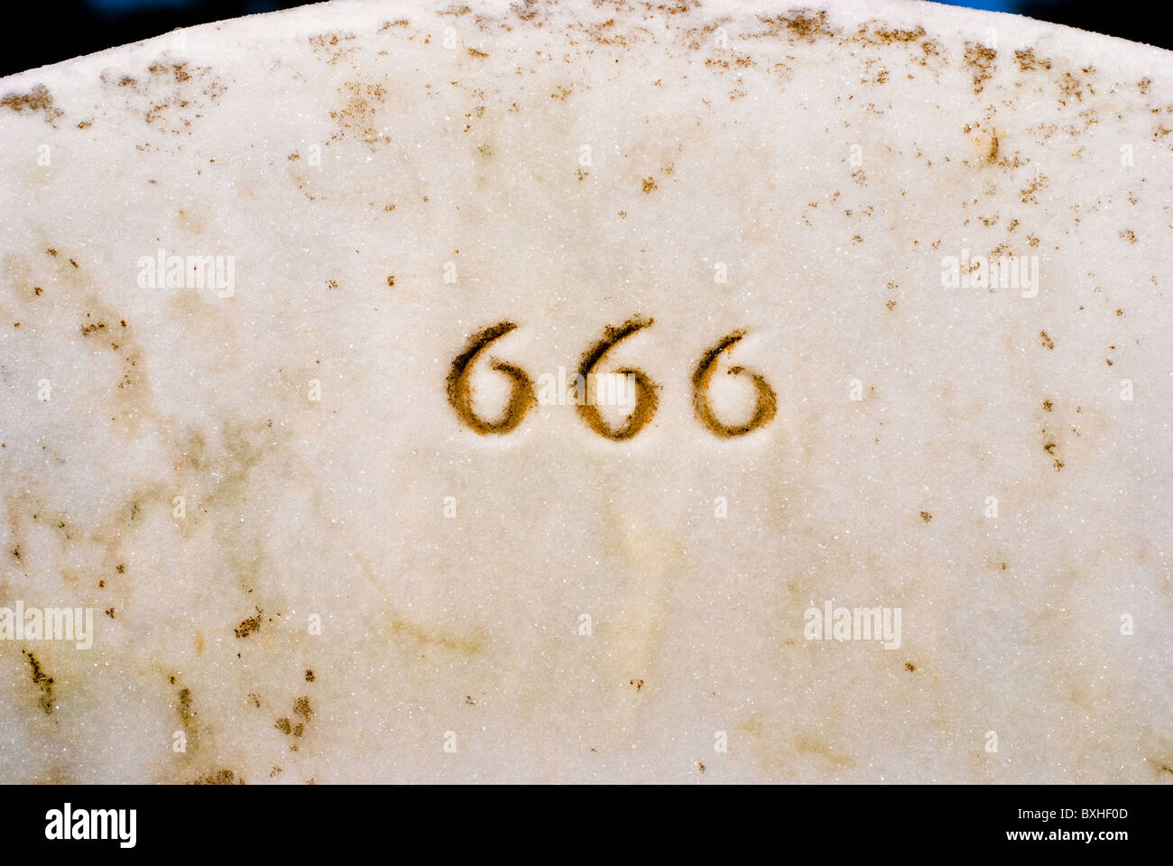 Closeup of 666 engraved in headstone Stock Photo