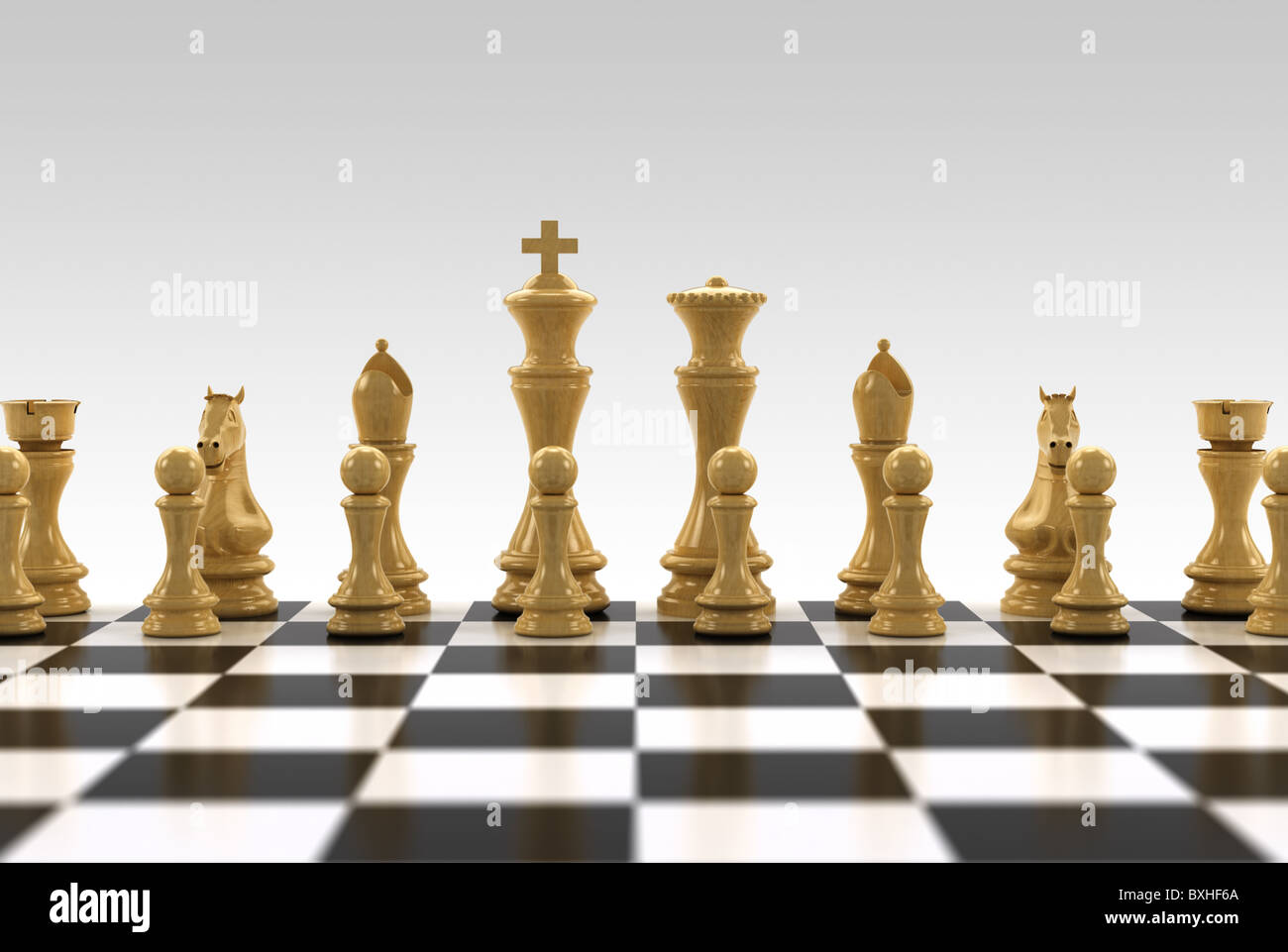 White chess pieces on chess board with very shallow depth of field - only the row with the king is in focus - Stock Image