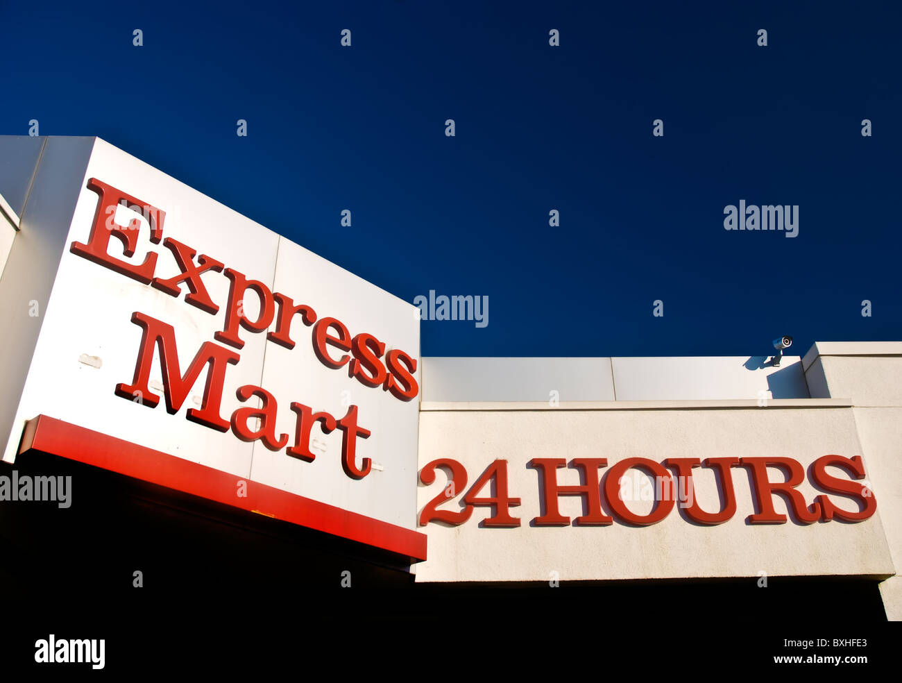 24 Hour Express Mart Sign on Building Stock Photo