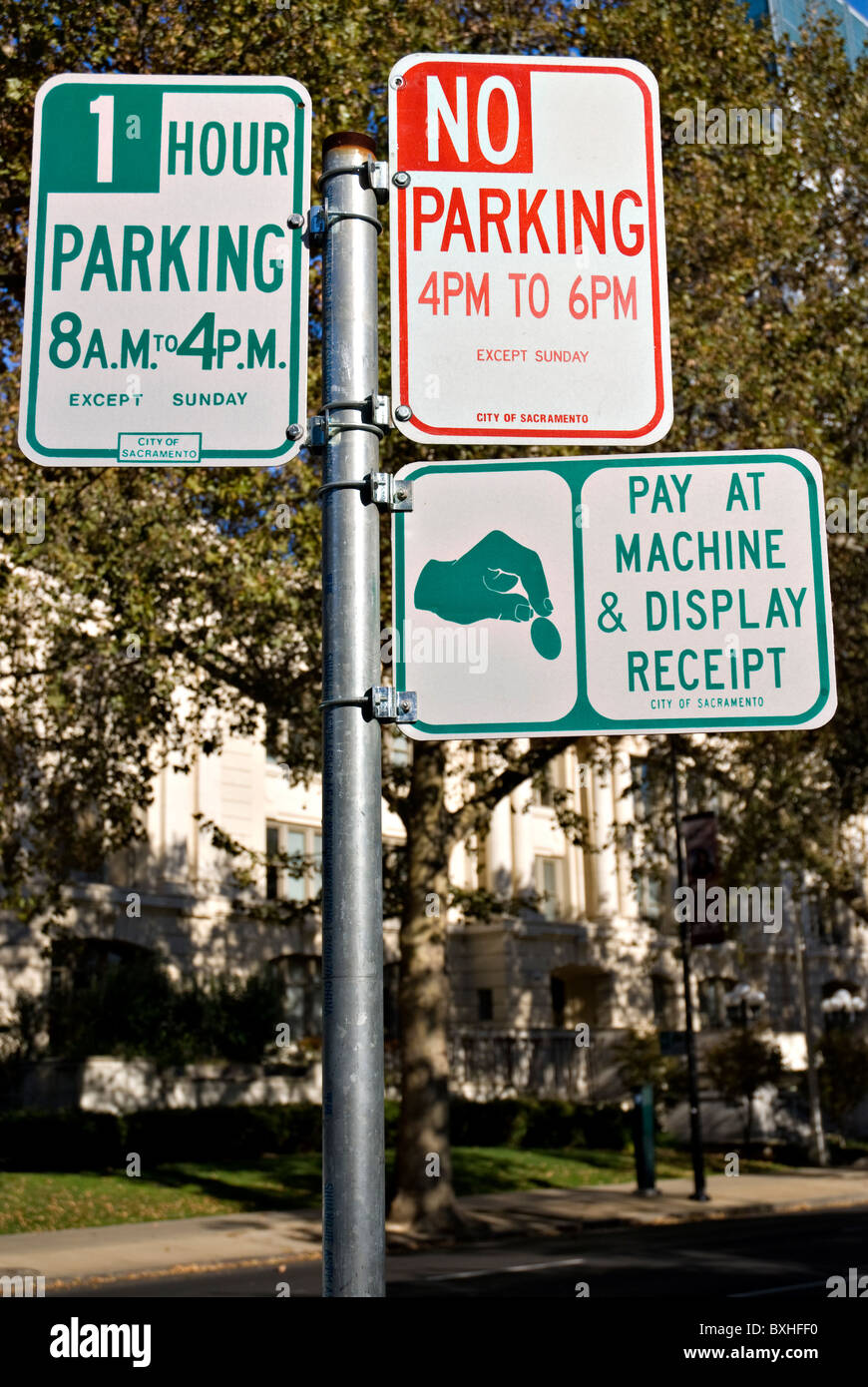 Three parking signs on one pole in Sacramento, California Stock Photo