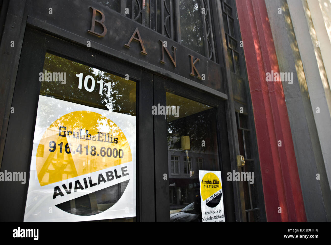 Grubb and Ellis for sale signs in a bank doorway Stock Photo