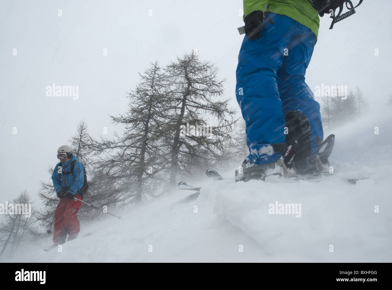 Two free skiers caught in bad weather in La Grave, french alps. - Stock Image