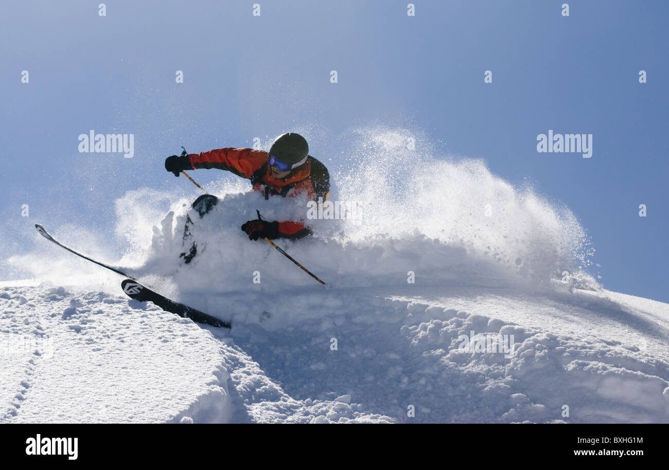 A free skier skiing in deep powder snow in Limone Piemonte, Italy. - Stock Image