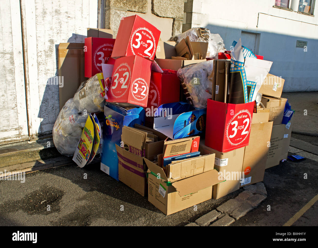 Waste cardboard ready to be collected for recycling, Uk - Stock Image
