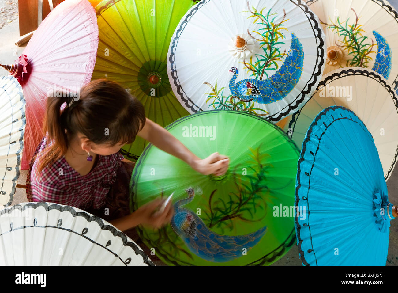 Painting parasols, Bo Sang, Umbrella Village nr Chaing Mai, Thailand - Stock Image