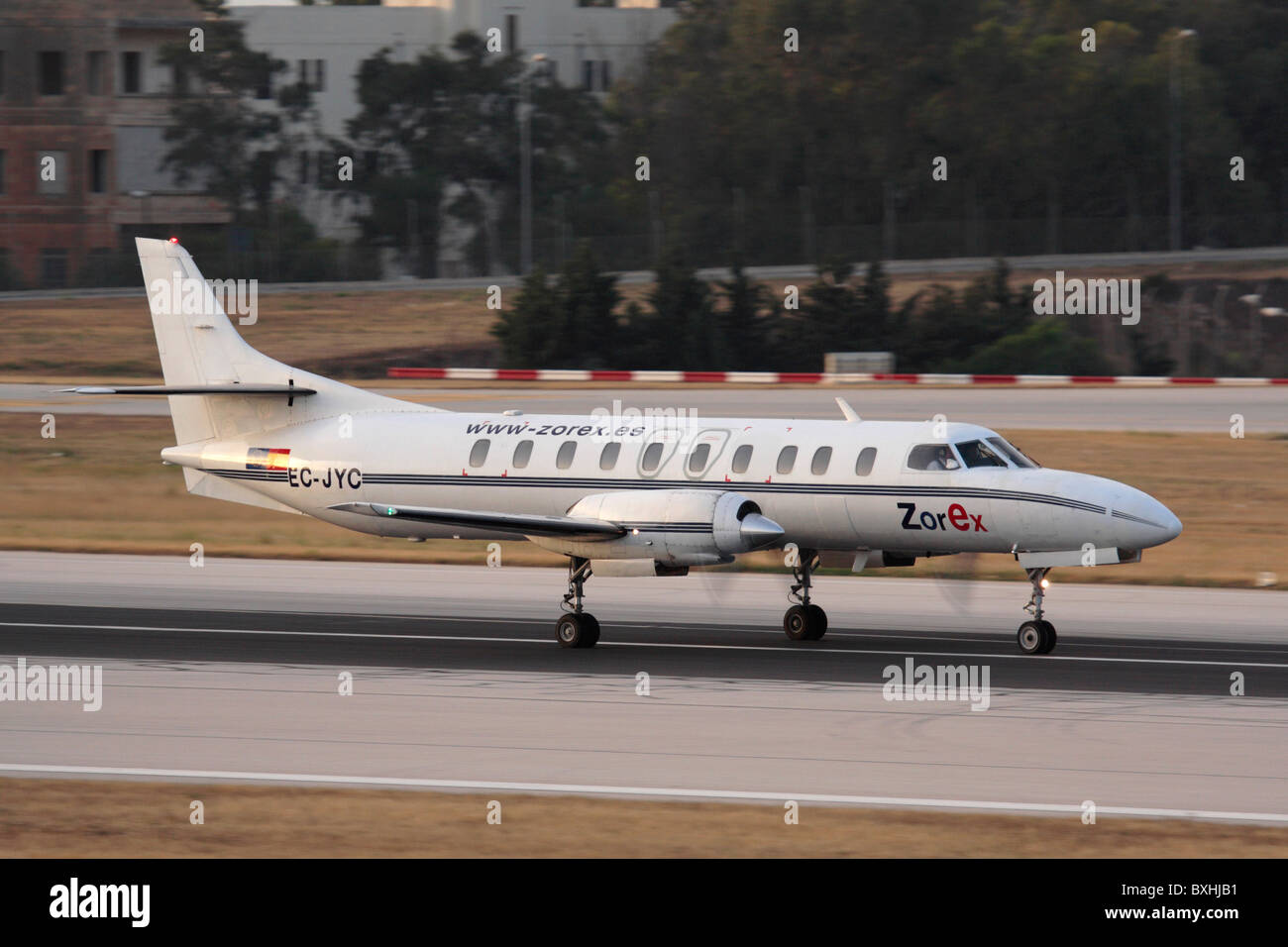 Fairchild Metro II operated by Zorex on takeoff - Stock Image