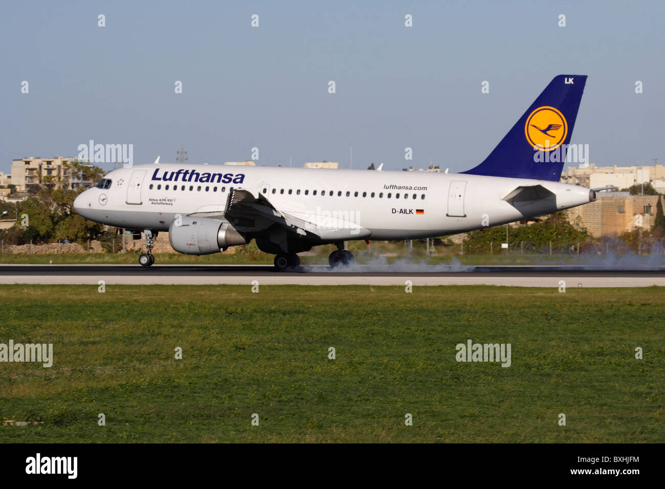 Lufthansa Airbus A319 airliner touching down on the runway while landing in Malta - Stock Image