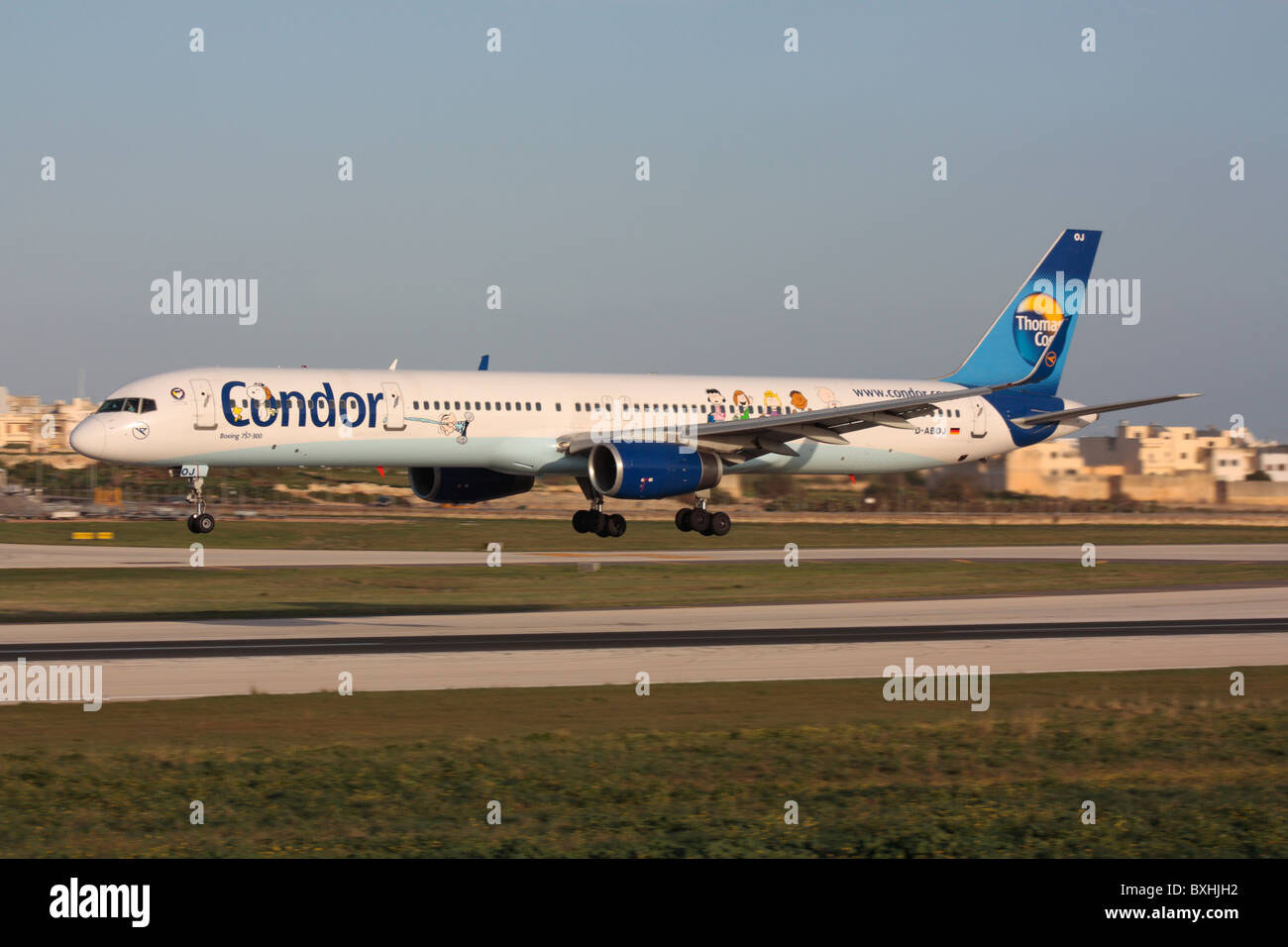 Condor Flugdienst Boeing 757-300 airliner in flight, making a low pass over the runway - Stock Image