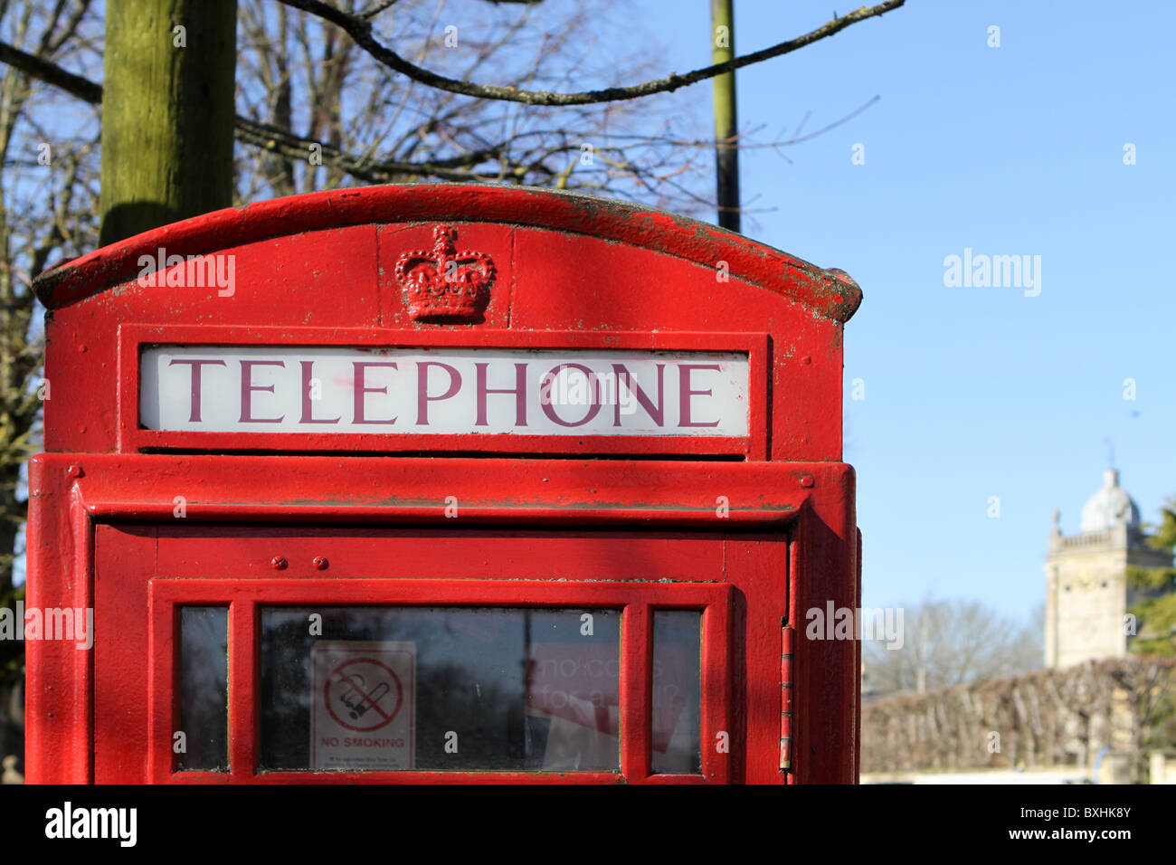 Traditional red telephone box in the tourist town of Bourton on the Water, Gloucestershire, UK - Stock Image