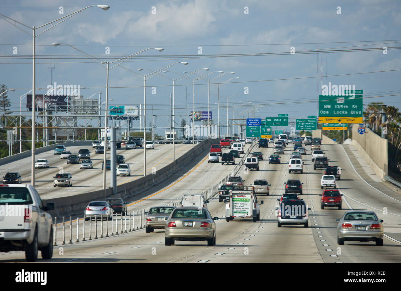 Traffic on the highway heading out of Miami at Opa Locka Boulevard, Florida, United States of America - Stock Image