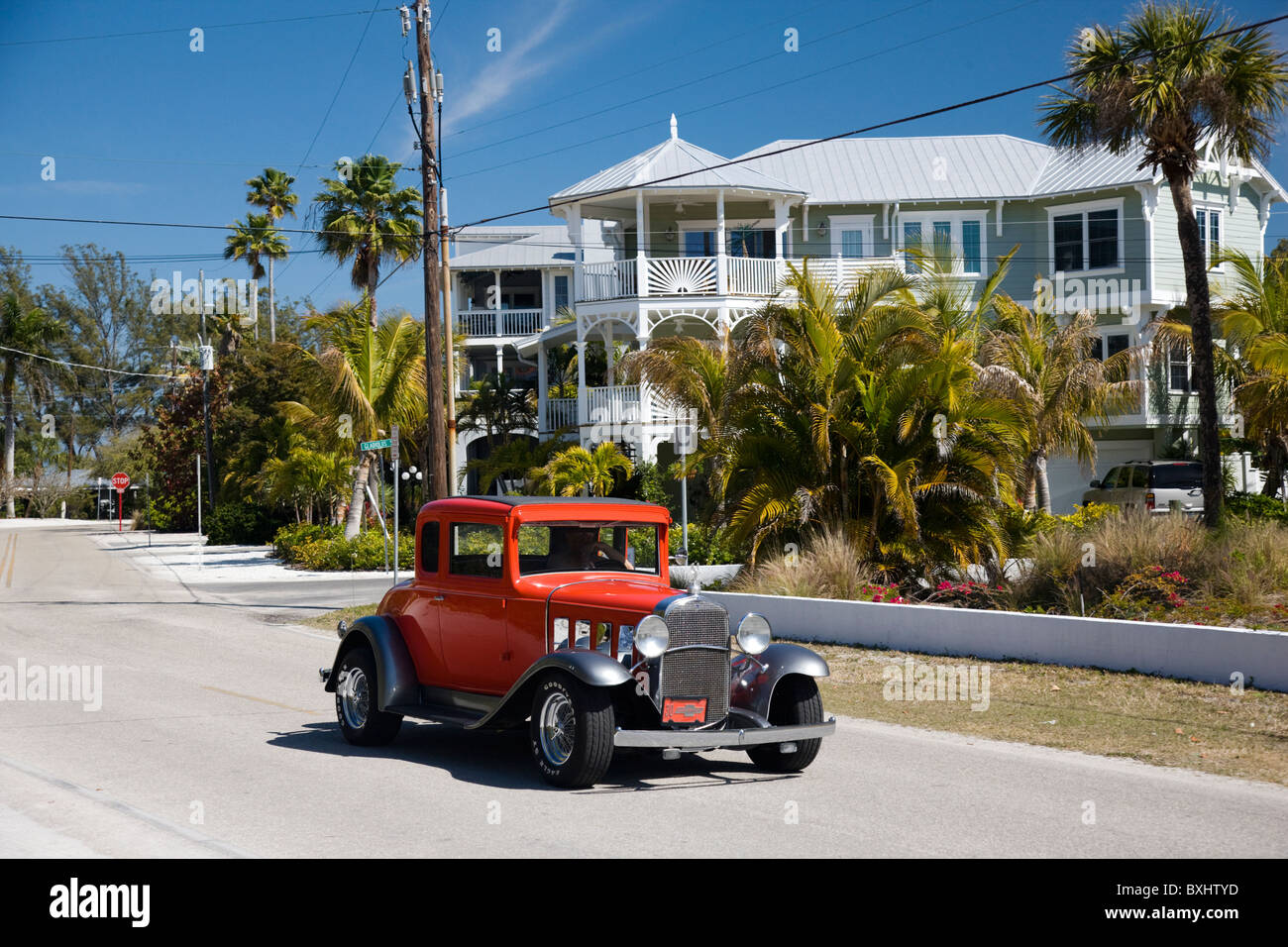 Vintage classic automobile, Chevrolet modelled, and luxury homes at vacation resort of Anna Maria Island, Florida, - Stock Image
