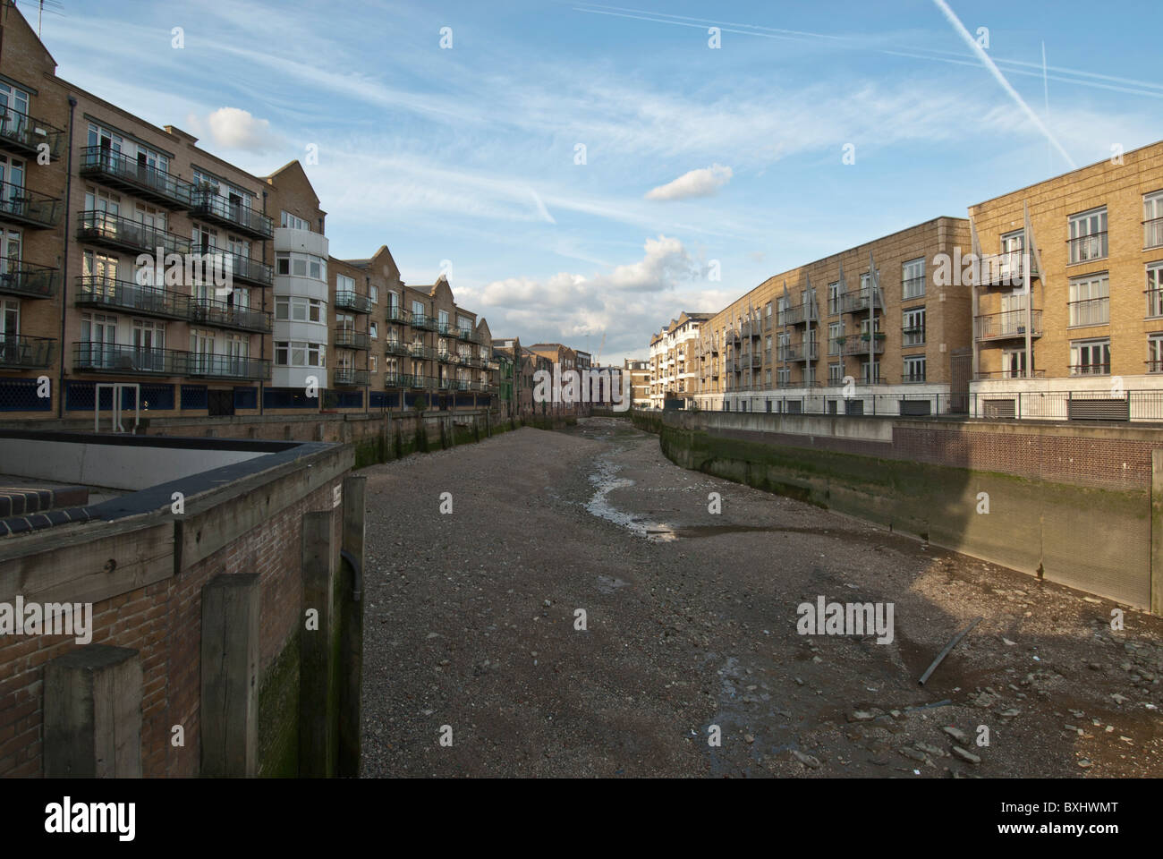 Limehouse dock tide out apartments, Tower Hamlets London Uk - Stock Image
