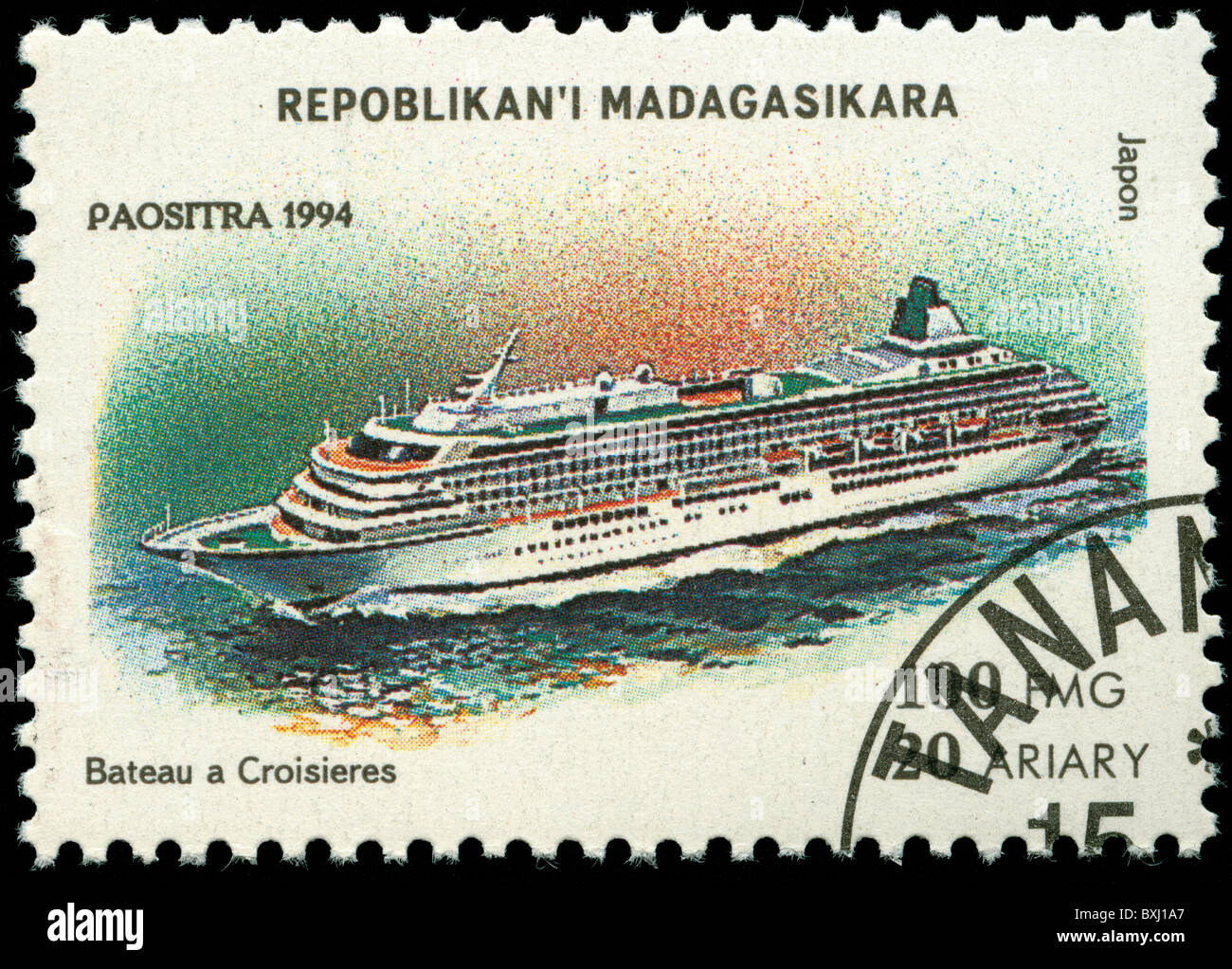 Postage stamp from Madagascar with picture of the passenger liner 'Japon' - Stock Image