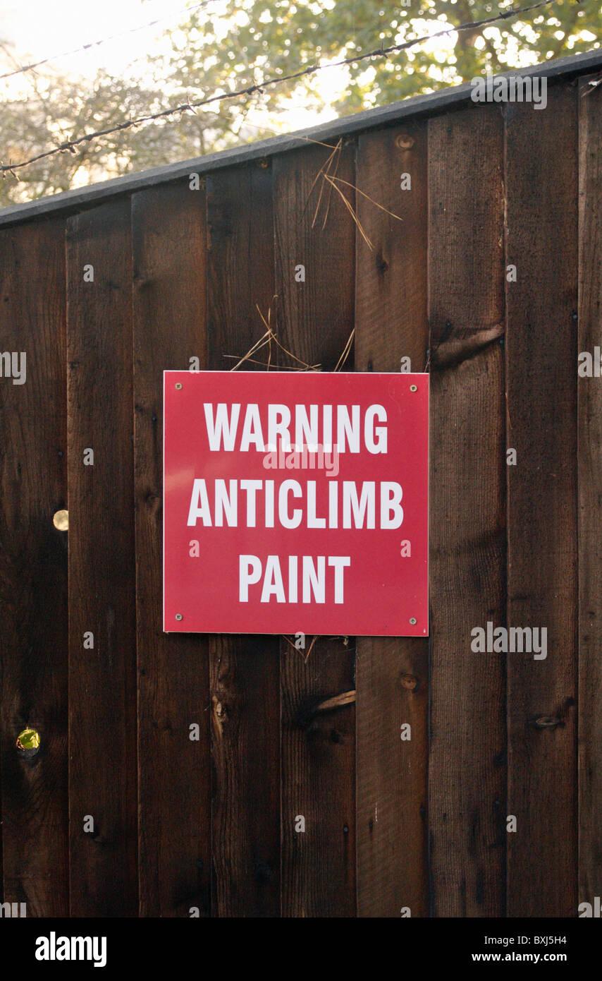 Anti-climb paint warning sign - Stock Image