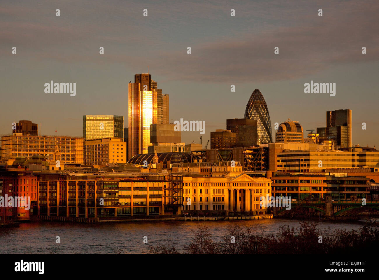 Late afternoon light on skyline of city financial district square mile, London, England - Stock Image