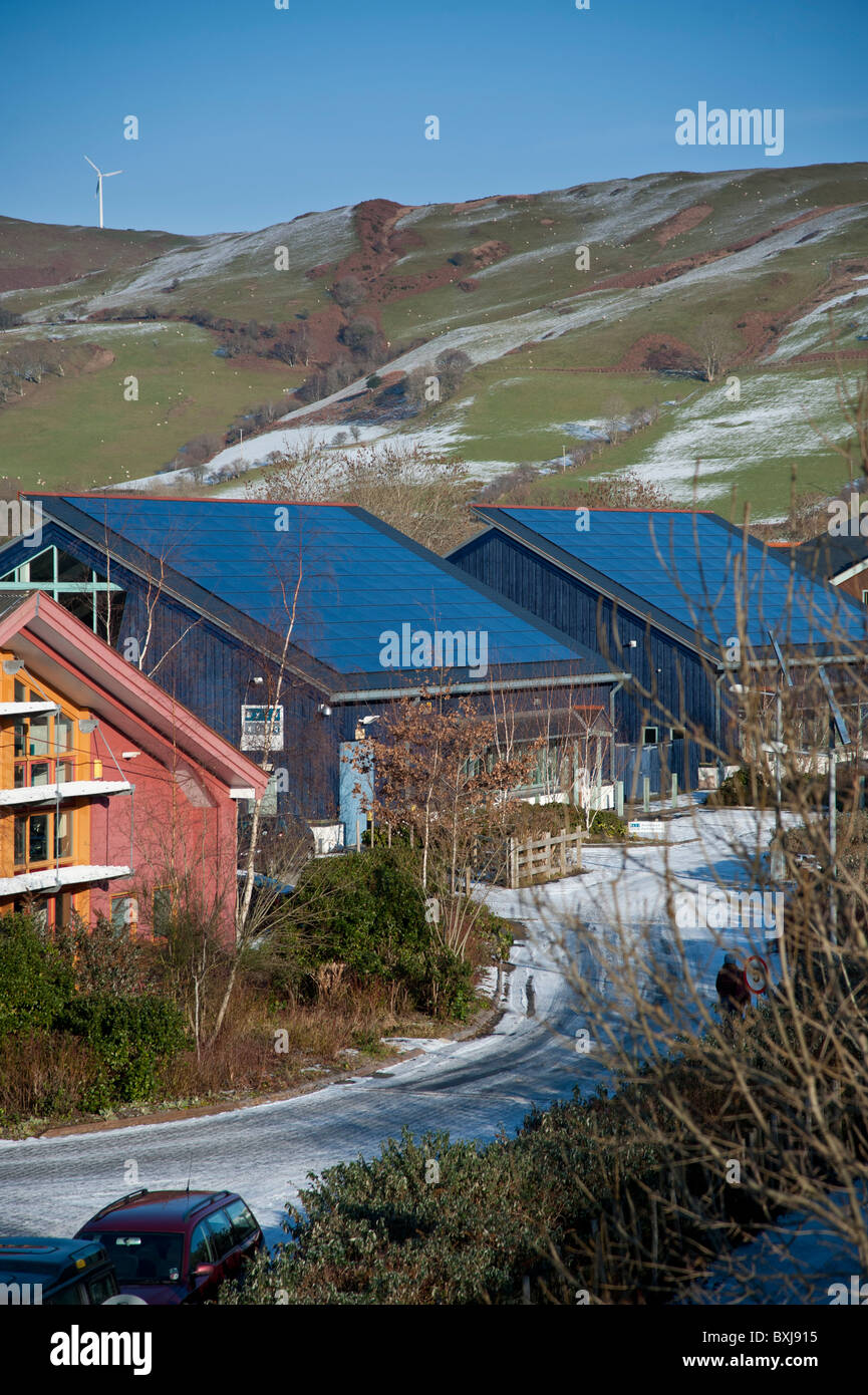 Photo voltaic solar panels on the roof of buildings in Dyfi Eco Park, Machynlleth Wales UK - Stock Image